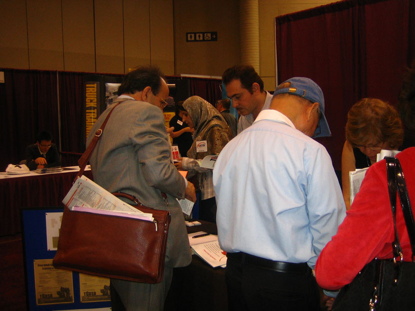 Visitors to Adult Education Program stand at the expo