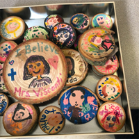 "Tin box with wooden hand-painted ""I Believe"" buttons"