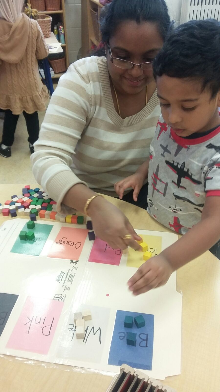 Parent and child using a file folder game