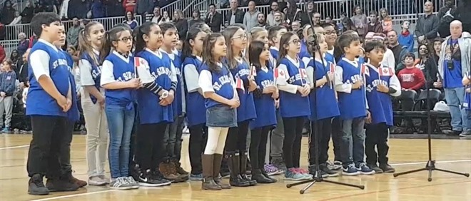 St. Sebastian Sings Anthem at Globetrotters Performance