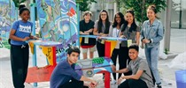 St. John Paul II Students Paint Chairs for Athletes' Village