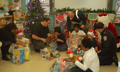 Fire Fighters' Toy Drive for Holy Family Students