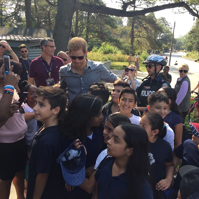 Prince Harry amongst students at the Invictus cycling event.