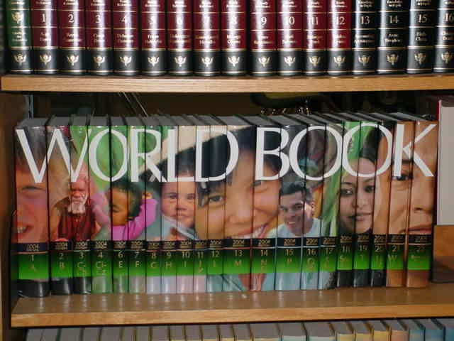 "photo of books on a shelf spelling ""World Book"""
