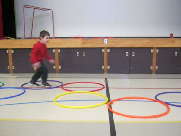 Students Jumping and Hopping Hoops