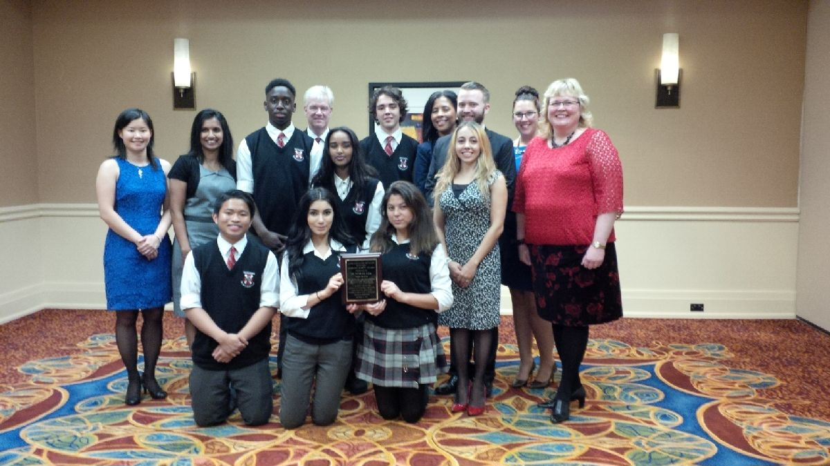 Staff & Students of St. Patrick group shot with award plaque