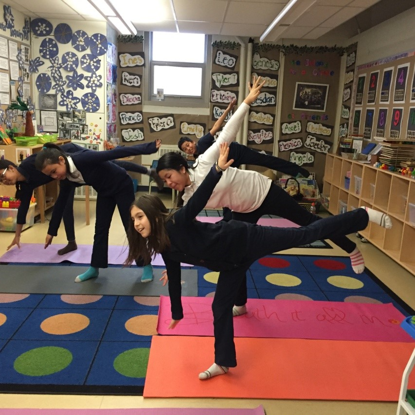 Students posing in Yoga stance