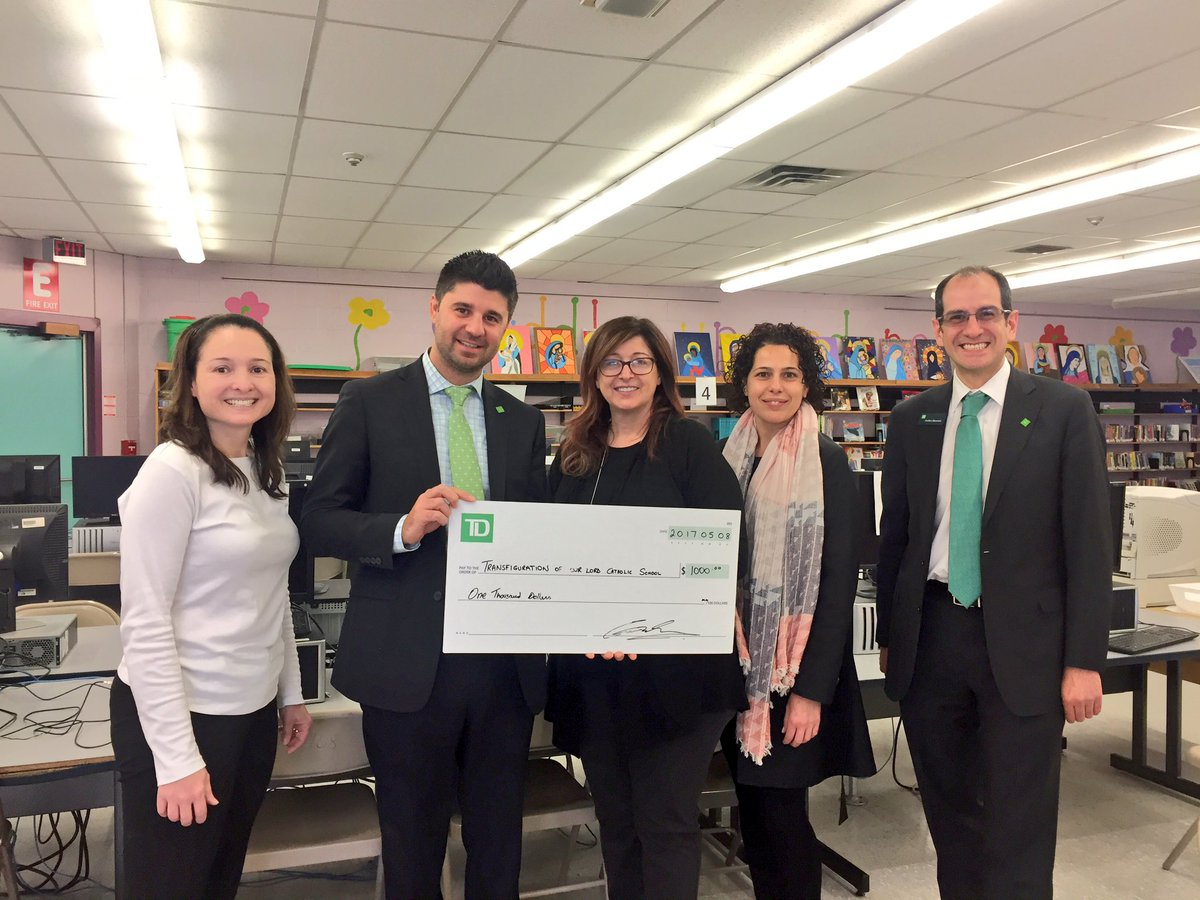 School and TD staff holding cheque.