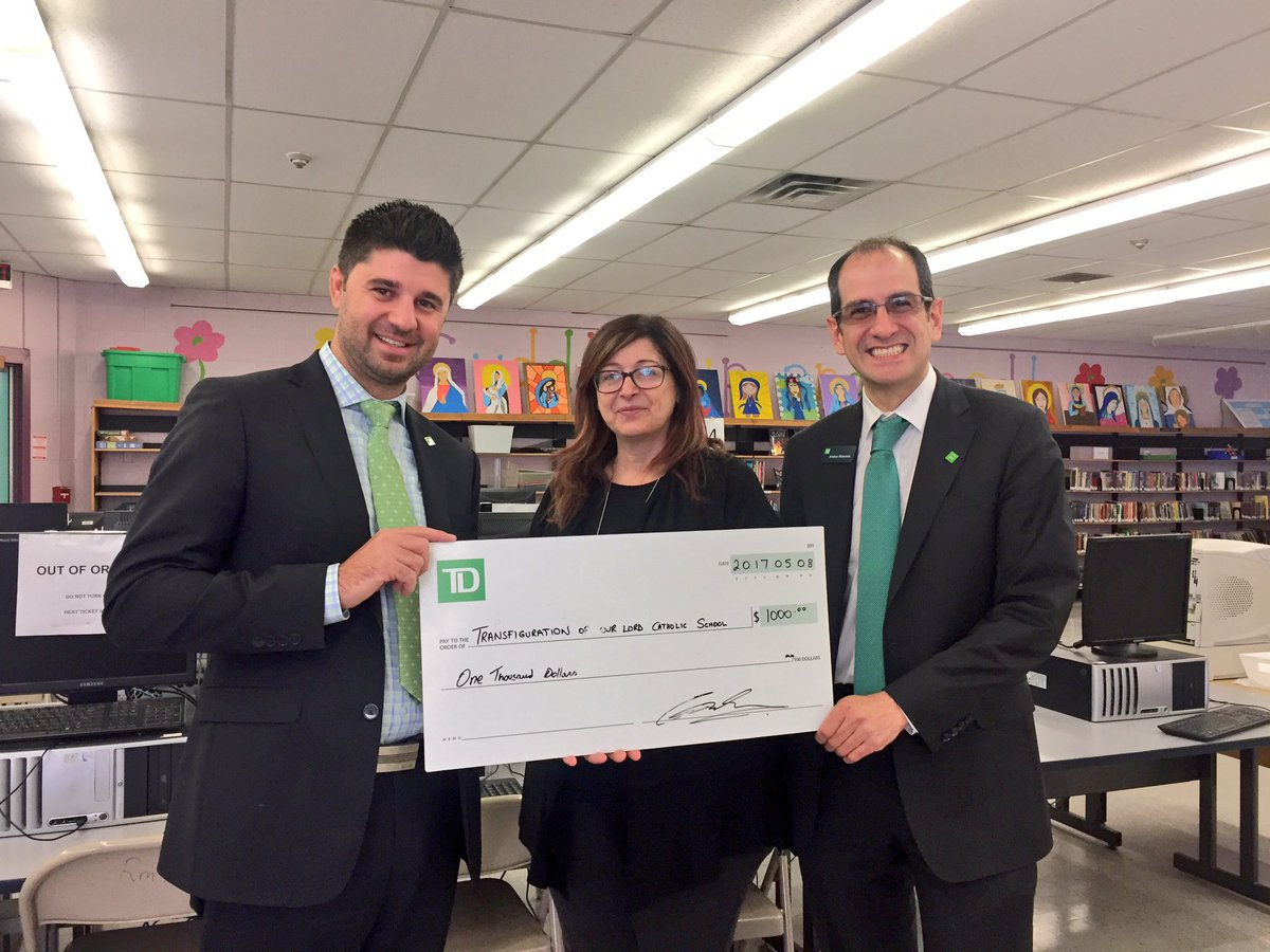 TD staf and principal hold cheque